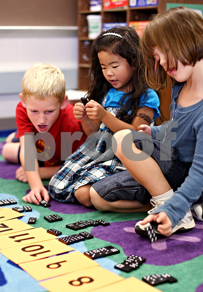 Beck Diefenbach  -  bdiefenbach@daily-chronicle.com<br /> <br /> North Elementary School kindergartners (from left) Jake O'Donnell, Jaly Polichnowski and Emma Doyle line up  dominoes under their totaled number during class in Sycamore, Ill., on Friday Sept. 25, 2009.