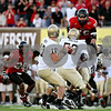Rob Winner – rwinner@daily-chronicle.com<br /> Idaho quarterback Nathan Enderle scans the field as the pocket holds late during Saturday's game in DeKalb.<br /> 09/26/2009