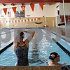 Beck Diefenbach  -  bdiefenbach@daily-chronicle.com<br /> <br /> Sophomore Tara Gidaszewski (sp?), left, and Senior Casey Jepsen rest during practice at the DeKalb High School swimming pool in DeKalb, ill., on Wednesday Sept. 2, 2009.