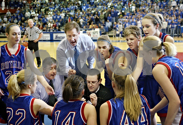 Beck Diefenbach – bdiefenbach@daily-chronicle.com<br /> <br /> Hinckley-Big Rock head coach Greg Burks talks to his team during a time-out during the fourth quarter of the 1A Super Sectional game against Dakota High School at Elgin Community College in Elgin, Ill., on Monday Feb. 23, 2009.
