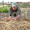 Beck Diefenbach  -  bdiefenbach@daily-chronicle.com<br /> <br /> Kevin Nodurft, of DeKalb, inspects his potato plants in his plot at the community garden in DeKalb, Ill., on Tuesday May 12, 2009. In this plot alone, Nodurft is planting onions, potatoes, shallots and garlic.