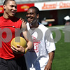 Beck Diefenbach  -  bdiefenbach@daily-chronicle.com<br /> <br /> Northern Illinois basketball players Jake Anderson, right, and Lee Fisher share a laugh during off season training at Huskie Stadium in DeKalb, Ill., on Friday June 26, 2009.