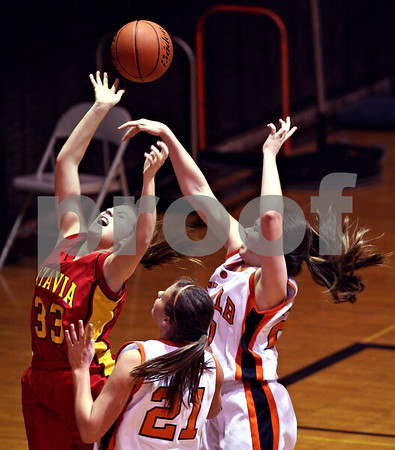 Beck Diefenbach  -  bdiefenbach@daily-chronicle.com<br /> <br /> Batavia's Hannah Schweigert (33) is fowled by DeKalb's Taylor White (20, right) during the third quarter of the game at DeKalb High School in DeKalb, Ill., on Tuesday Dec. 8, 2009.