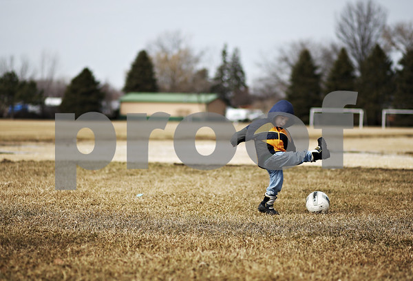 Beck Diefenbach – bdiefenbach@daily-chronicle.com<br /> <br /> Diego Rivas, 3, misses the ball while the playing soccer with his father in the Sycamore Community Park in Sycamore, Ill., on Friday March 13, 2009. Sycamore Community Park was expanded with funding from the New Deal in the 1930's.