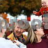 Rob Winner – rwinner@daily-chronicle.com<br /> <br /> Wally Thurow, who began what has become the Sycamore Pumpkin Festival, takes a moment to have his photograph taken with a family that was attending Wednesday's opening ceremony.<br /> <br /> 10/21/2009