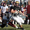 Beck Diefenbach  -  bdiefenbach@daily-chronicle.com<br /> <br /> Sycamore running back Joe Dougherty (28) weaves between Wheaton Academy defenders during the second quarter of the game at Sycamore High School in Sycamore, Ill., on Saturday Nov. 7, 2009. Sycamore defeated Wheaton Academy 42 to 0.