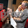 Beck Diefenbach  -  bdiefenbach@daily-chronicle.com<br /> <br /> Acting Mayor Kris Povlsen celebrates with supporters while holding his grandson Connor Dundas, 2, at River Heights Golf Club in DeKalb, Ill., on Tuesday April 7, 2009.