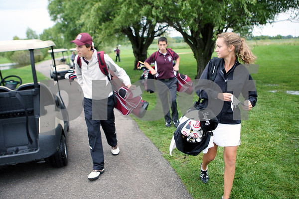 Rob Winner – rwinner@daily-chronicle.com<br /> Hayley Guyton, of the Kaneland golf team, heads to the fourth hole while playing against Marengo at the Hughes Creek Golf Club in Elburn on Thursday afternoon.<br /> 08/27/2009