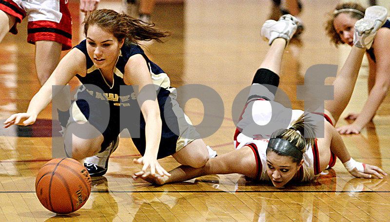 Rob Winner – rwinner@daily-chronicle.com<br /> Hiawatha's Cassie Lutz (left) and Indian Creek's Carson Day look to control a loose ball during the first quarter on Thursday December 17, 2009 in Shabbona, Ill.