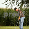 Beck Diefenbach  -  bdiefenbach@daily-chronicle.com<br /> <br /> DeKalb senior Andrew Morreale watches his putt during practice at River Heights Golf Course in DeKalb, Ill., on Tuesday Aug. 25, 2009.
