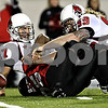 Rob Winner – rwinner@daily-chronicle.com<br /> Ball State quarterback Tanner Justice (17) loses the football after a hit from Northern defensive end Sean Progar during the first quarter.<br /> 11/12/2009