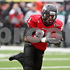 Rob Winner – rwinner@daily-chronicle.com<br /> Northern Illinois wide receiver Nathan Palmer finds the end zone after a pass from quarterback Chandler Harnish in the first quarter. Northern Illinois went on to defeat Western Michigan 38-3 on Saturday.<br /> 10/03/2009