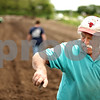 Beck Diefenbach  -  bdiefenbach@daily-chronicle.com<br /> <br /> Tim Fuller directs the planting of potatoes on the Erehwon Farm in Elburn, Ill., on Wednesday June 3, 2009.