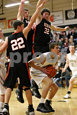 Rob Winner – rwinner@daily-chronicle.com<br /> Rob Winner – rwinner@kcchronicle.com<br /> Kaneland's Sean Paulick controls a rebound under his own basket during the second quarter.<br /> 12/04/2009