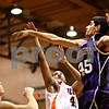 Beck Diefenbach  -  bdiefenbach@daily-chronicle.com<br /> <br /> DeKalb's Craig Lane (40, center) shot is blocked by Hampshire's Sarwan Khan (45) during the fourth quarter of the game at DeKalb High School on Tuesday Dec. 22, 2009. DeKalb defeated Hampshire 58 to 50.
