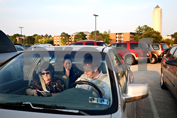 Beck Diefenbach  -  bdiefenbach@daily-chronicle.com<br /> <br /> Northern Illinois professors Tom Oates  (right), Kate Cady (left) and Duk Kim carpool together from the DeKalb campus to Chicago where they all live within a few miles of each other on Tuesday Sept. 9, 2009.