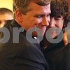 Beck Diefenbach  -  bdiefenbach@daily-chronicle.com<br /> <br /> Associate Judge Ron Matekaitis embraces his son Luke, right, after being sworn in at the DeKalb County Court House in Sycamore, Ill., on Friday May 1, 2008.