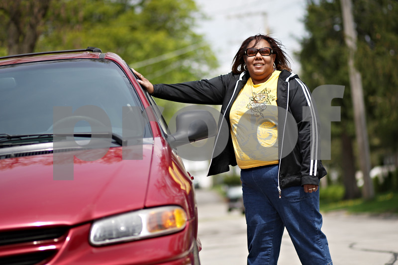 Beck Diefenbach  -  bdiefenbach@daily-chronicle.com<br /> <br /> Antoinette Burton has started a unique DeKalb business with her van, B.O.W.'s Taxi Service.