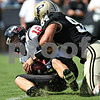 Beck Diefenbach – bdiefenbach@daily-chronicle.com<br /> <br /> Northern Illinois quarterback Chandler Harnish (12) is taken down by Purdue Eric Mebane (84) during the first half of the game against Purdue University in West Lafayette, Ind., on Saturday Sept. 19, 2009