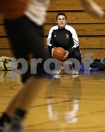 Beck Diefenbach  -  bdiefenbach@daily-chronicle.com<br /> <br /> DeKalb High School assistant coach Chad Pecka watches during practice at Huntley Middle School in DeKalb, Ill., on Thursday Jan. 22, 2008.