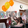 Beck Diefenbach  -  bdiefenbach@daily-chronicle.com<br /> <br /> Josephine Arce, right, wishes Ann Schroeter a happy 105th birthday during a birthday party for Ann at Bethany Health Care and Rehab Center in DeKalb, Ill., on Monday Feb. 16, 2009.