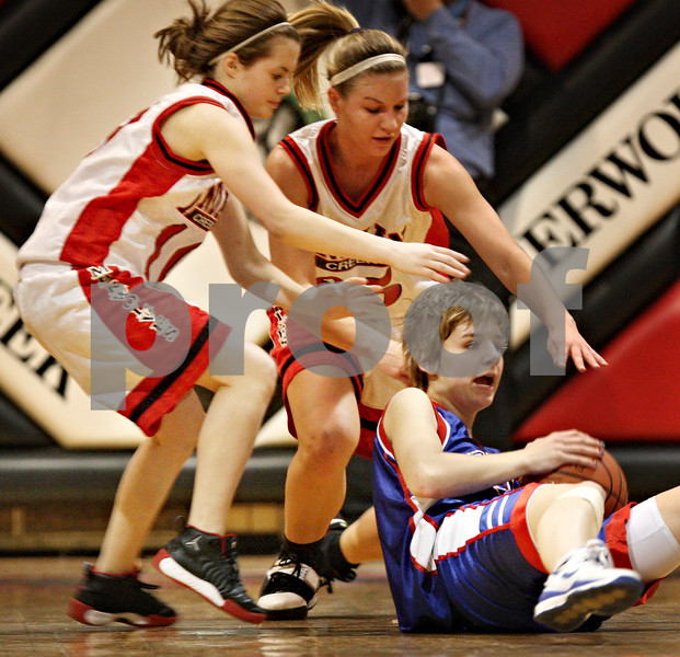 Beck Diefenbach  -  bdiefenbach@daily-chronicle.com<br /> <br /> Indian Creek senior Stevie Bozarth (10) and senior Lindsay Richardson (25) converge on Hinckley-Big Rock sophomore Tess Godhardt (33) during the second quarter of the game at Indian Creek High School in Shabbona, Ill., on Thursday Jan. 29, 2009. HBR beat Indian Creek 61 to 41.
