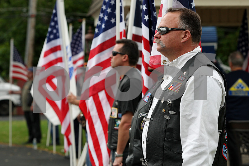 Rob Winner – rwinner@daily-chronicle.com<br /> Members of the Patriot Guard Riders hold up the American flag in front of the Ahlgrim & Sons Funeral & Cremation Services in Schaumburg on Friday for the wake of U.S. Army Pfc. Matthew Martinek.<br /> 09/25/2009<br /> The main subject did not want to be named.