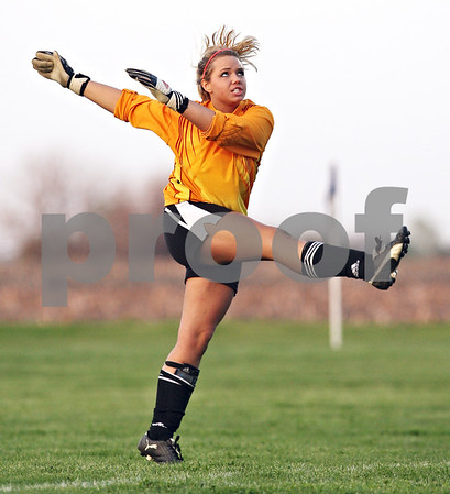 Beck Diefenbach  -  bdiefenbach@daily-chronicle.com<br /> <br /> Indian Creek goalie Kaylee Berg kicks the ball into play during the game against Hinckley-Big Rock at HBR High School in Hinckley, Ill., on Tuesday May 5, 2009.