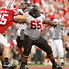 Beck Diefenbach  -  bdiefenbach@daily-chronicle.com<br /> <br /> Northern Illinois offensive lineman Jason Onyebuagu (65) fends of defenders during the first half of the game against University of Wisconsin in Madison, Wis., on Saturday Sept. 5, 2009