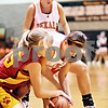 Beck Diefenbach  -  bdiefenbach@daily-chronicle.com<br /> <br /> Batavia's Kelsey Stone (55, left) and DeKalb's Kelli Gerace (21, right) fight for the ball during the first quarter of the game at DeKalb High School in DeKalb, Ill., on Tuesday Dec. 8, 2009. DeKalb defeated Batavia 33 to 21.
