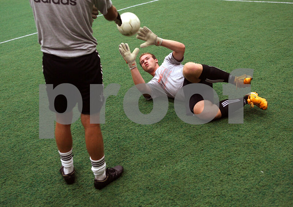 Beck Diefenbach  -  bdiefenbach@daily-chronicle.com<br /> <br /> DeKalb goalie Steve Murphy reaches for a ball during practice at the DeKalb Park and Recreation Center in DeKalb, Ill., on Wednesday August 26, 2009.