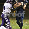 Beck Diefenbach  -  bdiefenbach@daily-chronicle.com<br /> <br /> North Shore Country Day School defensive back Jake Gordon (11) can't stop Hiawatha quarterback Jason Keneway (5) during the first quarter of the game at Hiawatha High School in Kirkland, Ill., on Friday Oct. 23, 2009.