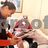 Beck Diefenbach  -  bdiefenbach@daily-chronicle.com<br /> <br /> Jim Willrett, an ALS patient, shares a laugh with registered nurse Sharon Wells, of DeKalb County Hospice, when she jokingly tickles his toe at his home in Malta, Ill., on Thursday Oct. 16, 2009.