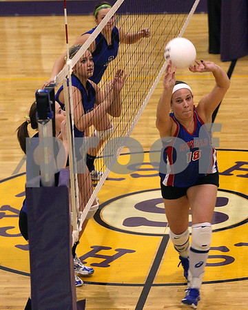 Rob Winner – rwinner@daily-chronicle.com<br /> Cassie Kroner, of Hinckley-Big Rock, tries to get a handle on a ball during the first of two games during the Class 1A Serena Sectional final. Hinckley-Big Rock fell to Newark 24-26 and 17-25 to end their season.<br /> 11/05/2009