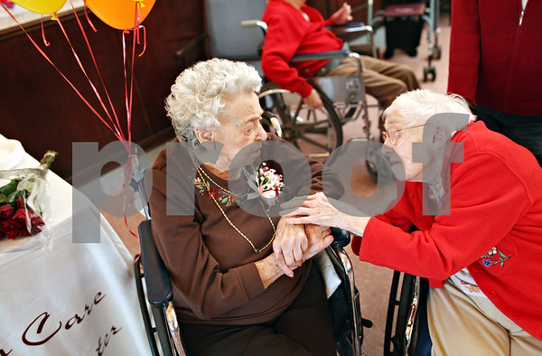 "Beck Diefenbach  -  bdiefenbach@daily-chronicle.com<br /> <br /> Esther Tilley, right, wishes Ann Schroeter a happy 105th birthday during a birthday party for Ann at Bethany Health Care and Rehab Center in DeKalb, Ill., on Monday Feb. 16, 2009. Tilley, who is 100 years old, said ""I don't think I'll see you again."""
