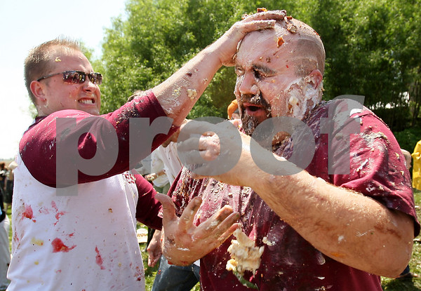 Beck Diefenbach  -  bdiefenbach@daily-chronicle.com<br /> <br /> Tim Carlton, of Sycamore, receives another handful of pie to his head during the world's largest pie fight in Genoa, Ill., on Saturday June 13, 2009. Over 200 people participated.