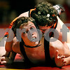 Rob Winner – rwinner@daily-chronicle.com<br /> Rob Winner – rwinner@kcchronicle.com<br /> DeKalb's Tyler Larson (top) holds down Batavia's Dylan Beach during their match on Thursday night in Batavia.<br /> 12/03/2009 <br /> 112 lbs.<br /> Larson wins