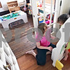 Beck Diefenbach  -  bdiefenbach@daily-chronicle.com<br /> <br /> Patty Ihm plays house with one of her two foster children in their DeKalb home on Friday May 8, 2009. IHM also has four children of her own, one of which is adopted.