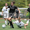 Beck Diefenbach  -  bdiefenbach@daily-chronicle.com<br /> <br /> Sycamore's Nici Newquist (left) breaks away from  fouls Wheaton Academy's Kerrin Clancy (right) during the first half of the Class 2A state semifinal game at North Central College in Naperville, Ill., on Friday June 5, 2009. Sycamore lost to Wheaton Academy 5-2 and will face Chatham Glenwood for third place on Saturday.