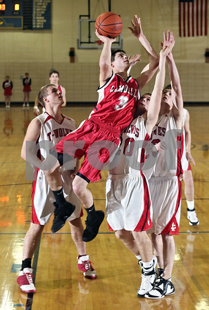 Beck Diefenbach  -  bdiefenbach@daily-chronicle.com<br /> <br /> La Moille guard Jesse Monroe (3) leaps for a lay up during the first quarter of the game against Indian Creek High School during the Little Ten Conference Basketball Tournament at Somonauk High School in Somonauk, Ill., on Monday Feb. 2, 2009.