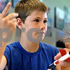 Rob Winner – rwinner@daily-chronicle.com<br /> Kevin Drendel, 11, of Malta, explains how he built his model rocket during the DeKalb County 4-H Show at the DeKalb County Farm Bureau in Sycamore on Thursday morning.<br /> 07/16/2009