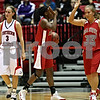 Beck Diefenbach  -  bdiefenbach@daily-chronicle.com<br /> <br /> Ball State guard Porchia Green (3) and guard Audrey McDonald (33) celebrate after Northern Illinois guard Kylie York (3) makes a foul during the first half of the game at the NIU Convocation Center in DeKalb, Ill., on Wednesday Jan. 21, 2009.
