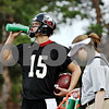 Rob Winner – rwinner@daily-chronicle.com<br /> Ryan Morris hydrates himself between drills during the first day of Northern Illinois football practice.<br /> 08/06/2009