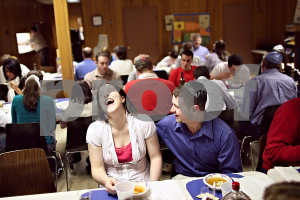 Beck Diefenbach  -  bdiefenbach@daily-chronicle.com<br /> <br /> Kelyy Killham, left, and her boyfriend Joseph Kaufmann share a laugh during a Passover seder meal hosted by Congregation Beth Shalom in DeKalb, Ill., on Thursday April 9, 2009.