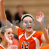 Beck Diefenbach – bdiefenbach@daily-chronicle.com<br /> <br /> DeKalb's Courtney Thomas (12) celebrates with teammates following a point during the third period of the game against Kaneland at Kaneland High School in Maple Park, Ill., on Saturday Sept. 19, 2009.