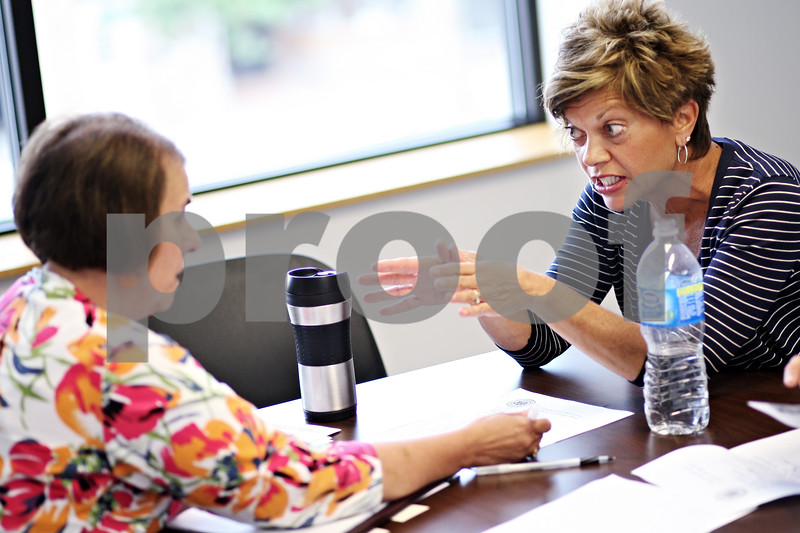 "Beck Diefenbach  -  bdiefenbach@daily-chronicle.com<br /> <br /> (Right) Twyla Edwards, of Sycamore, speaks with district director Sue Klinkhamer during rep. Bill Foster's staff's ""Neighborhood Office Hours"" at the Sycamore Center in Sycamore, Ill., on Thursday Aug. 20, 2009. Edwards came to express her concerns about, among others, President Barack Obama's health care bill."