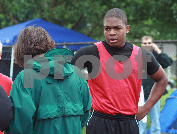 Randi Stella – rstella@daily-chronicle.com<br /> <br /> LeShun Daniels (right) waits for the results of the 100 meter dash during the Youth Invitational Track Meet hosted by the Huskie Track Club in DeKalb, Ill., on Saturday, June 13th, 2009.