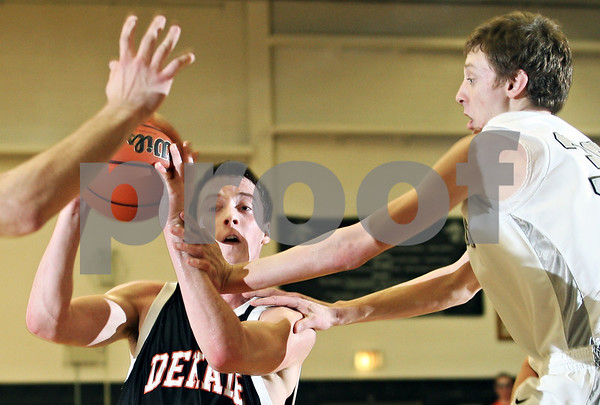 Beck Diefenbach  -  bdiefenbach@daily-chronicle.com<br /> <br /> DeKalb forward Grant Olsen (34) attempts to slip a pass by Kaneland forward Chaon Denlinger (30) during the second quarter of the game at Kaneland High School in Maple Park, Ill., on Friday Jan. 23, 2009.