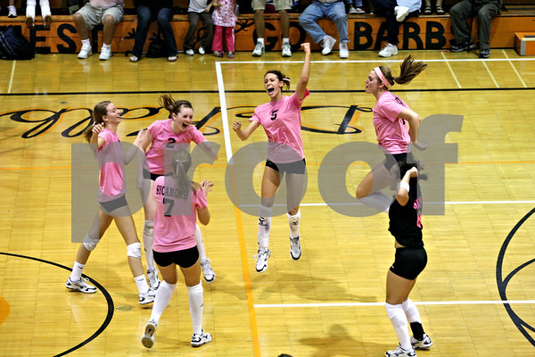 Rob Winner –  rwinner@daily-chronicle.com<br /> Members of the Sycamore volleyball team celebrate their 21-25, 25-21, 25-23 Western Sun Conference victory against DeKalb on Tuesday night in Dekalb. It was Sycamore's 13th straight win against DeKalb dating to 2002.<br /> 09/22/2009