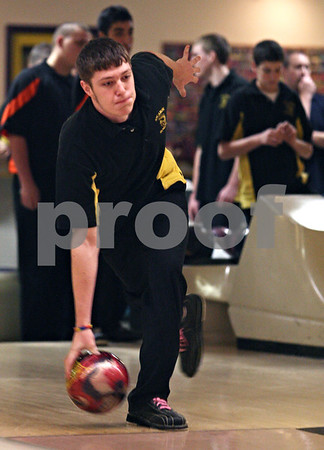 Beck Diefenbach  -  bdiefenbach@daily-chronicle.com<br /> <br /> Sycamore's Austin Ricker rolls his ball during warm ups for a match at the Four Season's bowling alley in Sycamore, Ill., on Wednesday Dec. 2, 2009.